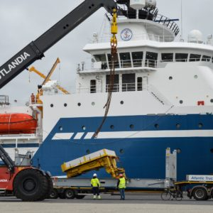 Conqueror Esbjerg transports a heavy cargo from Esbjerg, Denmark, to Aarhus, with Panama as the end destination