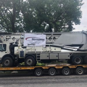 Conqueror Chicago moves a project cargo of 3 specially equipped trucks containing concrete placement telescoping conveyor systems